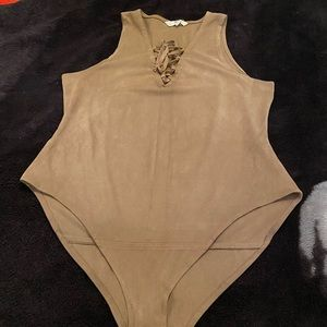 brown body suit